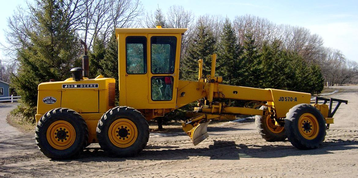 South Side Sand & Gravel's yellow John Deere Road Grader